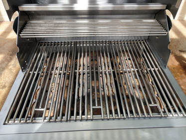A stainless steel BBQ Grill in Scottsdale AZ w/ ceramic briquettes.